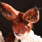 Foam face and ears. Hair flocking, punching and laying